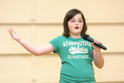 Sixth-grader Paige Mattingly sings.