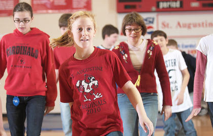 Caroline Buckman was out in front as she and her fellow sixth-graders performed the Cuban Shuffle.