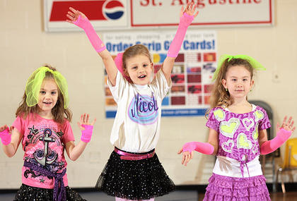 "Julia Rose Wheatley (kindergarten), Nicole Montgomery (second grade), and Lauren Bradshaw (first grade) prove that ""Girls Just Wanna Have Fun"" by dancing to the Cyndi Lauper tune."