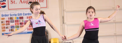 Fourth-graders Libby Palagi, left, and Sarah O&#039;Daniel perform a gymnastics routine.