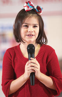 Mollie Smothers, a third-grader, performs a pair of songs by Justin Bieber. 