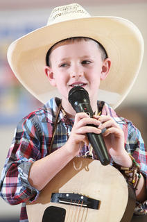 "Kindergartner Benjamin Thompson keeps things a little bit country with his performance of Jason Aldean's ""Big Green Tractor."""