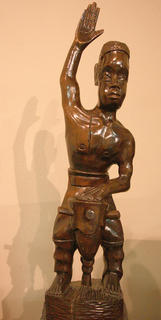 A sculpture shows an African drummer.