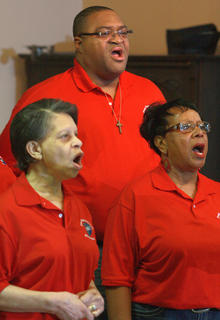From left, Carrie Thornton, Anthony Farris and Helen McKay sing with the Campbellsville First Baptist Church choir.