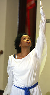 Sheila Taylor raises her hand during a performance by the liturgical dancers from Campbellsville First Baptist Church.