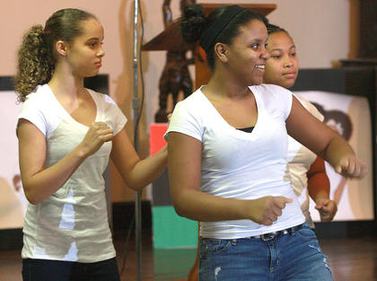 From left, Carrington McKay, Etiyah Thompson and KeTayah Taylor keep the beat during a performance by the Campbellsville First Baptist Church youth dancers.