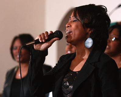 Yohonda Allen sings lead vocals during a song by The Witness.