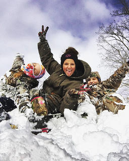 Pictured, from left, are Kaylee Reed, Grace Farmer and Jailyn Allen having fun in the snow.