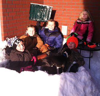 These kiddos take a break in their snow fort they built for a snowball fight. Pictured, front row from left, are Jacobi Summers and Luke Mattingly; back row from left, are Keaton McCauley, JR Mattingly and Chloe Spears.