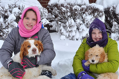 Reece and Rose Caldwell are pictured with their four-legged fur babies Jesse and Josie.