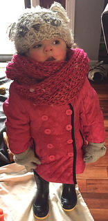 Adalyn Abell is all bundled up so she stays warm out in the snow.
