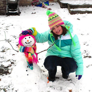 Pictured is Emma Hunt, 8, with her snowman. She is the daughter of Josh and Nora Hunt.