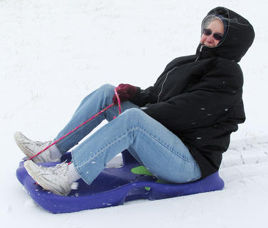 Margaret Carrier enjoys sledding with her granddaughter, Cassidy Funk. Photo taken by Rose Lee Funk.