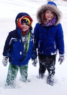 Emma Hardin, 7, and Gabe Hardin, 5, enjoy the snow on Jan. 25.