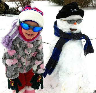 Misha McKinney is pictured with her snowman Ollie. Photo taken by Jenni Hall.
