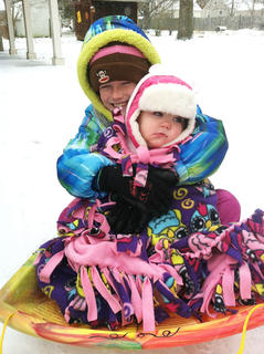 Gracie Bradshaw and her cousin, Evelyn Scott, went sledding in the snow. Photo taken by Amanda Morgeson.