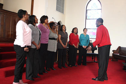 Members of the Johnson AME Zion Church Choir in Springfield perform two gospel songs. They were led by Tyron Burton.