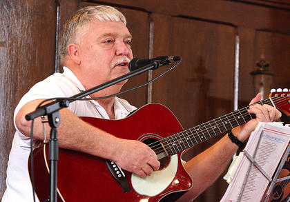 Gordon Webb of the United Methodist Church in Lebanon performed several songs, including an interesting rock-n-roll version of Amazing Grace. He was accompanied by Mike Hill.