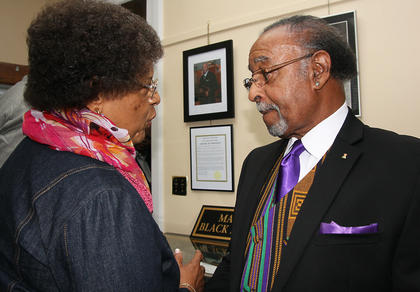 Mary Mattingly chats with Jerry Evans during the opening of the black history exhibit.