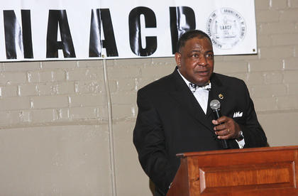 During the NAACP black history celebration on Feb. 23, Charles Bell reads from Dr. Martin Luther King Jr.'s eulogy for children who were killed when someone bombed a church in Birmingham, Alabama, in 1963.