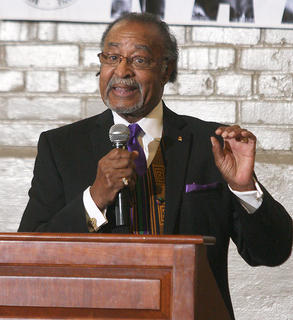 Jerry Evans, president of the Marion County chapter of the NAACP, addresses the hundreds of people who attended the black history celebration Sunday at Centre Square.