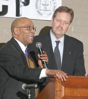 Rev. Tommy Calhoun introduces Marion County Judge/Executive John G. Mattingly during Sunday's black history celebration at Centre Square.