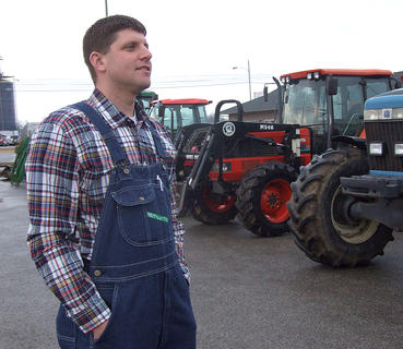 Agriculture teacher Daniel Mattingly looks over the assembled tractors.