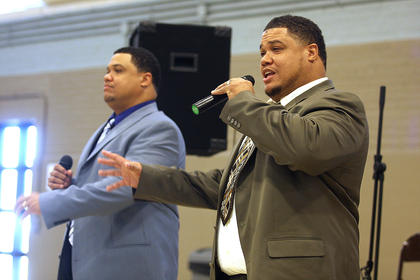 Eric McElroy and his twin brother, Derrick, sing a song of worship for the crowd.