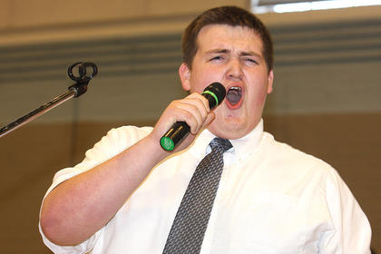 Matthew Simmons, one of the members of the Bardstown group, Young Men United, sings during the celebration Sunday.
