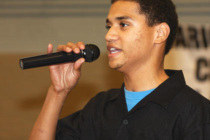 L.J. Goldring one of the members of the Bardstown group, Young Men United, sings during the celebration Sunday.