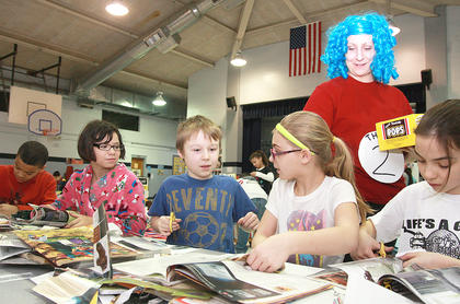 From left: Dominique White, Sabrina Bragg, Peyton Thomas, Paris Dye, and Lexie Wilkerson work on an art project as Thing 2 (teacher Jessica Floyd) checks on them.