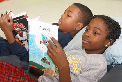Quashaun Gunn, left, and TyVal Furmon dive into their books.