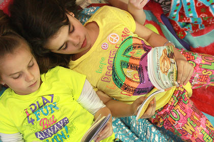Lindsey McCullough, left, and Gabbie Brockman got comfortable while they read.