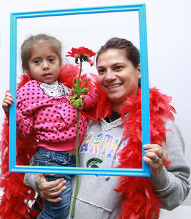 Brianna Andres, 3, and Lisa Castillo pose for a photo during the party.