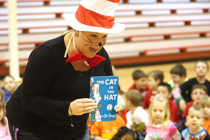 Elaine Rahn, a librarian at the Marion County Public Library, reads Cat in the Hat to students Friday morning at St. Augustine Grade School.