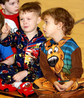 Alex Smith, left, and Ty Johnson discuss the Cat in the Hat while they sit comfortably in their pajamas and house slippers.