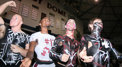 Members of the MCHS student section show their support for  the Lady Knights with body paint.