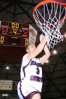 Makayla Epps makes the first cut of the net after Marion County defeated Elizabethtown to win the Fifth Region championship.