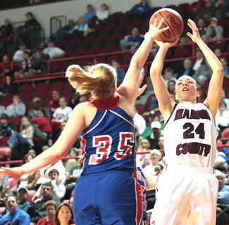 Bre Elder (No. 24) shoots over Montgomery County sophomore Macie Spence.