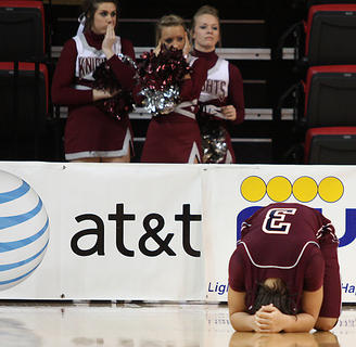 Lady Knights sophomore Makayla Epps collapsed to the ground after a heartbreaking loss to Manual in the semifinals of the Girls Sweet 16 basketball tournament.