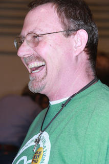 "Tom Robey of the ""A Family Off Hair"" team laughs while waiting for the head shaving to begin. Robey was also inducted into the Knights of the Bald Table for participating in this event for the seventh time."