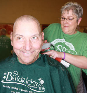 Bob Mattingly was all smiles while stylist Connie Smith shaves his head.