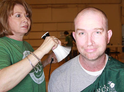 Pat Thomas gets the brush off from stylist Polly Miller. This was Thomas's third year as a shavee.