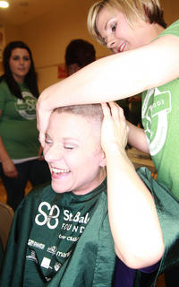 Enterprise Publisher Stevie Lowery rubs her head for the first time with her new haircut.