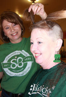 Gwen Mattingly of Citizens National Bank donated several ponytails to Locks of Love, which makes wigs for people who've lost their hair, along with her head shaving for St. Baldrick's. Stylist Polly Miller is pictured as well.