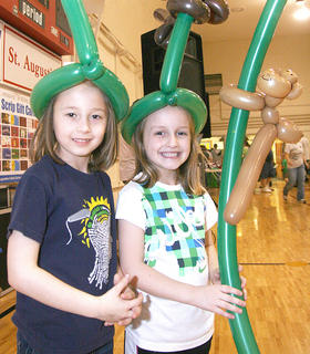 Caitlyn Brady, 6, and Kaylee Reed, 5, accessorized their St. Baldrick&#039;s outfits with balloons.