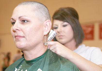 Julie Robey returned to St. Baldrick&#039;s as a shavee for the second time this year. Mindy Garrett did the honors.
