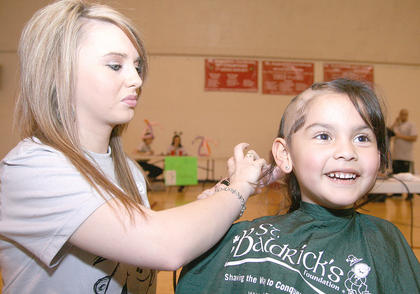 Maria Calmo, 5, was all smiles as she had her head shaved by Laken Kirkland.