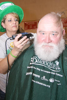 Kim Childers got to shave Santa, a.k.a. Stephen Norris, during this year&#039;s St. Baldrick&#039;s event.