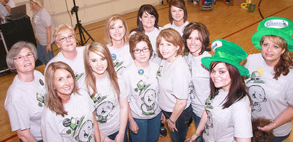 A dozen stylists volunteered their time and equipment to shave heads during this year's St. Baldrick's event. Front row (from left): Jessica Baker, Laken Kirkland, Darlene Morgan, Polly Miller, Sherry Moore and Taylor Claypool. Back row: Vickie Childers, Connie Smith, Eileen Hughes, Candi Skaggs, Mindy Garrett and Kim Childers.